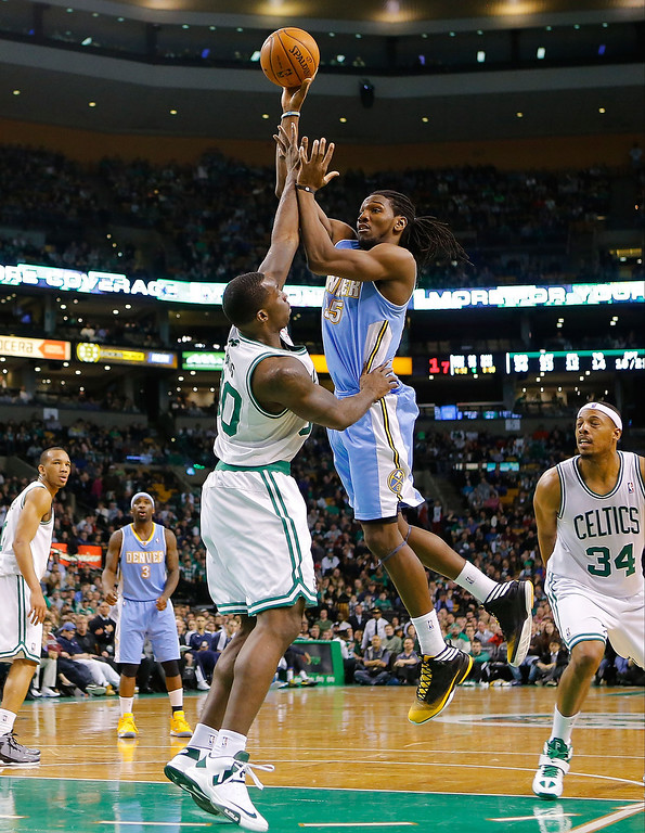 . BOSTON, MA - FEBRUARY 10: Kenneth Faried #35 of the Denver Nuggets takes a shot over Brandon Bass #30 of the Boston Celtics during the game on February 10, 2013 at TD Garden in Boston, Massachusetts.  (Photo by Jared Wickerham/Getty Images)
