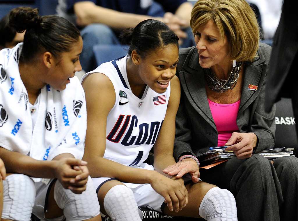 . Connecticut\'s Moriah Jefferson, center, smiles as associate head coach Chris Dailey, right, speaks to her, and teammate Kaleena Mosqueda-Lewis, left, sits near in the second half of a first-round game in the women\'s NCAA college basketball tournament against Idaho in Storrs, Conn., Saturday, March 23, 2013. Jefferson scored 16 points as Connecticut won 105-37. (AP Photo/Jessica Hill)