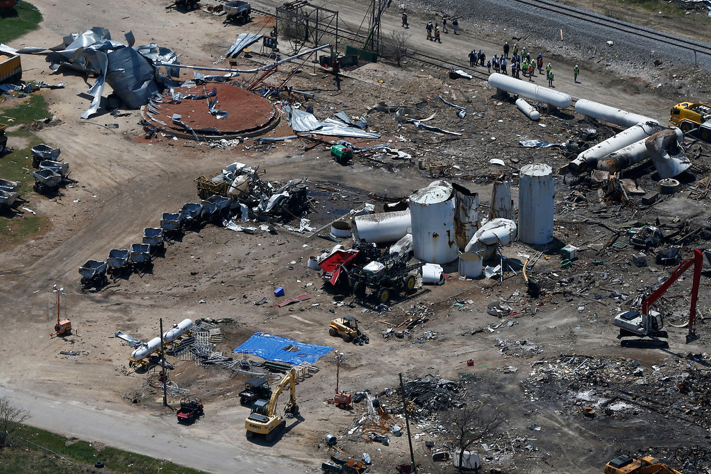 . The damage from the fertilizer plant explosion is seen from helicopters in accompanying President Barack Obama in West, Texas, Thursday, April 25, 2013, en route to Baylor University in Waco,Texas, where the president was to speak at a memorial service. (AP Photo/Charles Dharapak)