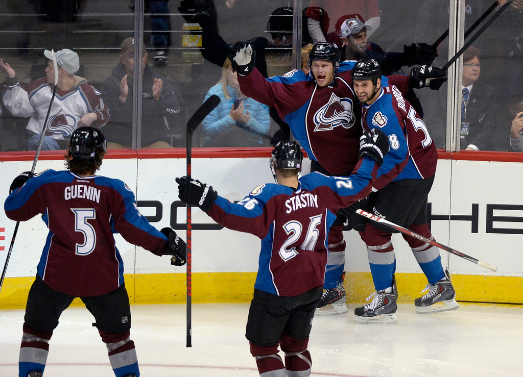 . Colorado Avalanche defenseman Erik Johnson (6) celebrates his goal with Colorado Avalanche left wing Patrick Bordeleau (58) during the seonc period October 17, 2013 at Pepsi Center.(Photo by John Leyba/The Denver Post)