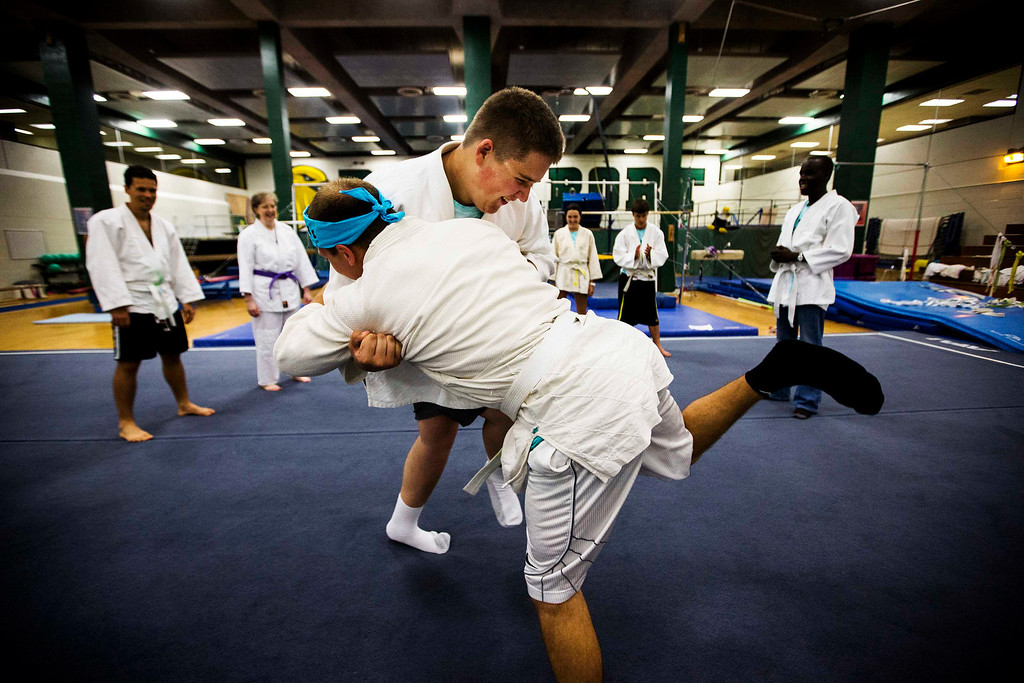 . Nicholas Walker takes part in Judo with a counselor at Camp Abilities in Brockport, New York, June 25, 2013. Camp Abilities is a not-for-profit week-long developmental camp using sports to foster greater independence and confidence in children who are blind, visually impaired, and deaf-blind. Photo taken June 25, 2013.       REUTERS/Mark Blinch