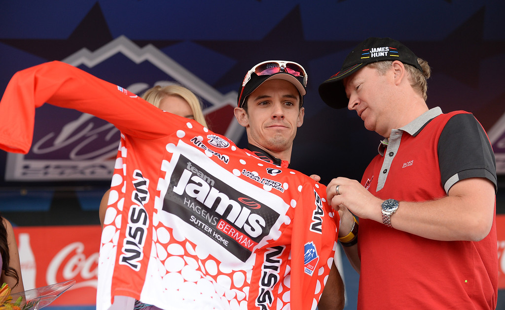 . Matt Cooke (USA) of Jamis-Hagens Berman p/b Sutter Home puts on the 2nd stage King of Mountain jersey after finishing stage two from Aspen to Breckenridge. Photo By Hyoung Chang/The Denver Post)