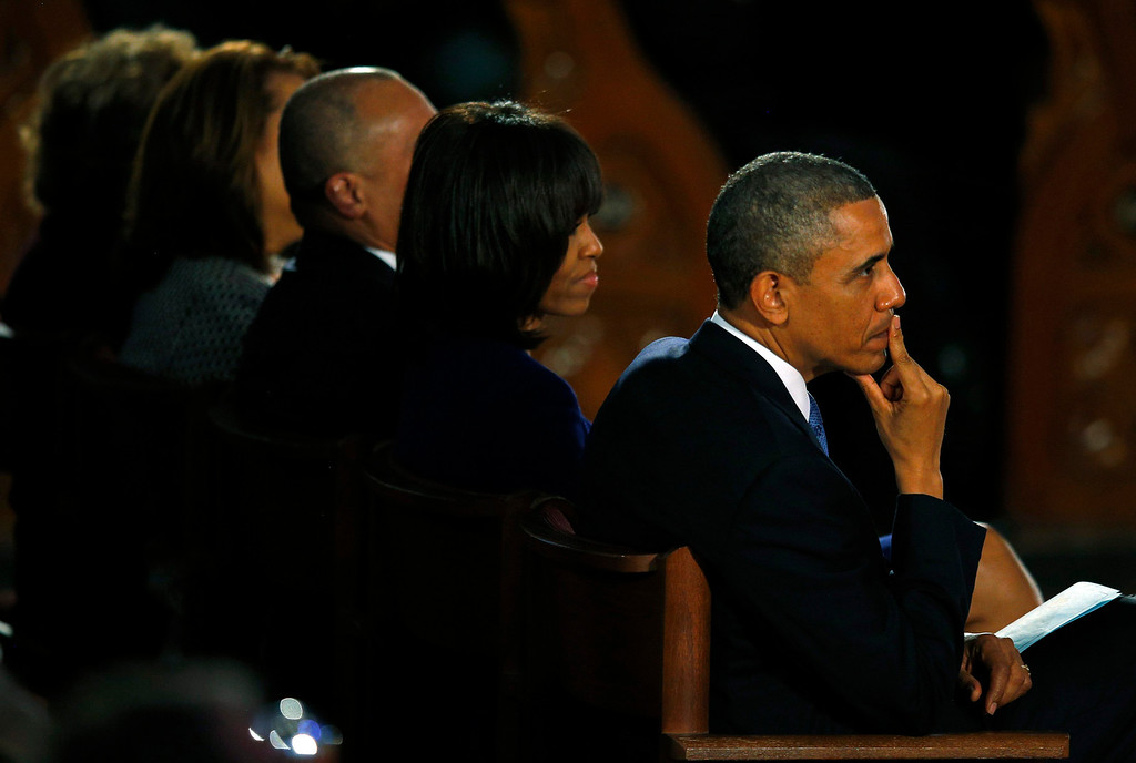 . U.S. President Barack Obama and his wife Michelle attend an inter-faith memorial service for the victims of the bombing at the Boston Marathon in Boston, Massachusetts April 18, 2013.       REUTERS/Brian Snyder