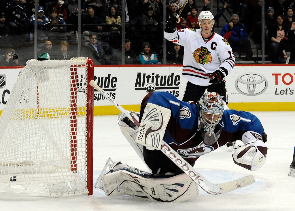 . Colorado Avalanche goalie Semyon Varlamov (1), of Russia, lets the puck slip past for a goal as Chicago Blackhawks center Jonathan Toews (19) celebrates during the second period of an NHL hockey game, Monday, March 18, 2013, in Denver. (AP Photo/Jack Dempsey)