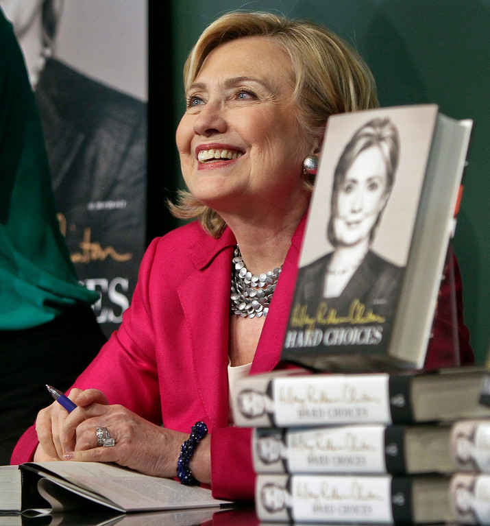 """. HiIlary Rodham Clinton listens before signing a copy of her book, \""""Hard Choices\"""" on Tuesday June 10, 2014, at Barnes and Noble bookstore in New York.    (AP Photo/Bebeto Matthews)"""