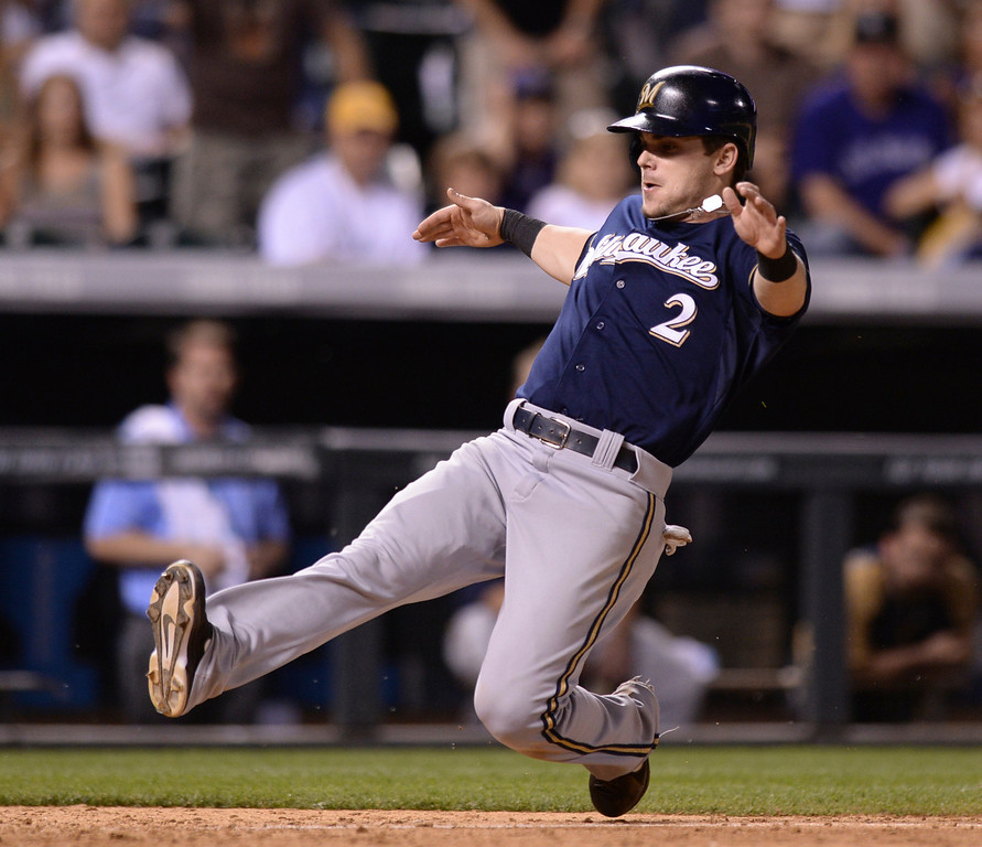 . DENVER, CO - JUNE 20: Brewers baserunner Scooter Gennett added another run in the ninth inning. The Milwaukee Brewers defeated the Colorado Rockies 13-10 at Coors Field Friday night, June 20, 2014. Photo by Karl Gehring/The Denver Post