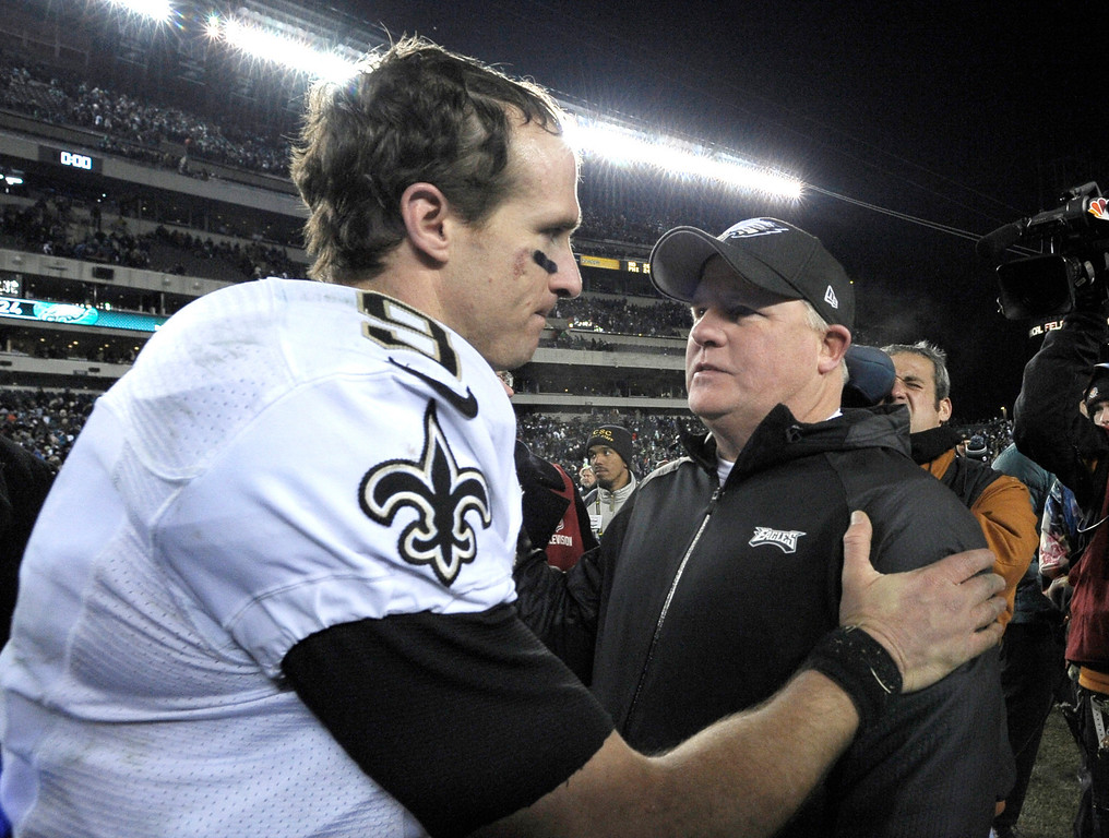 . Philadelphia Eagles head coach Chip Kelly, right, meets with New Orleans Saints\' Drew Brees after an NFL wild-card playoff football game, Saturday, Jan. 4, 2014, in Philadelphia. New Orleans won 26-24. (AP Photo/Michael Perez)