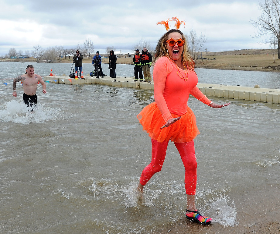 . Kim Cintella appears to be feeling a chill after her plunge.The 31st annual Boulder Polar Plunge, at the Boulder Reservoir on New Year�s Day, to help the Boulder County AIDS Project and connectBCAP.  Cliff Grassmick/Daily Camera