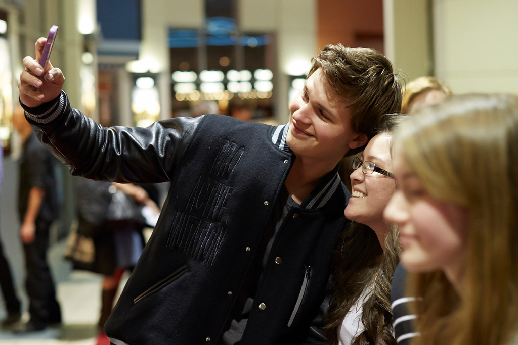 ". ""Divergent\""  actor Ansel Elgort greets fans on the red carpet at Mall of America on March 5, 2014 in Bloomington, Minnesota. (Photo by Adam Bettcher/Getty Images)"