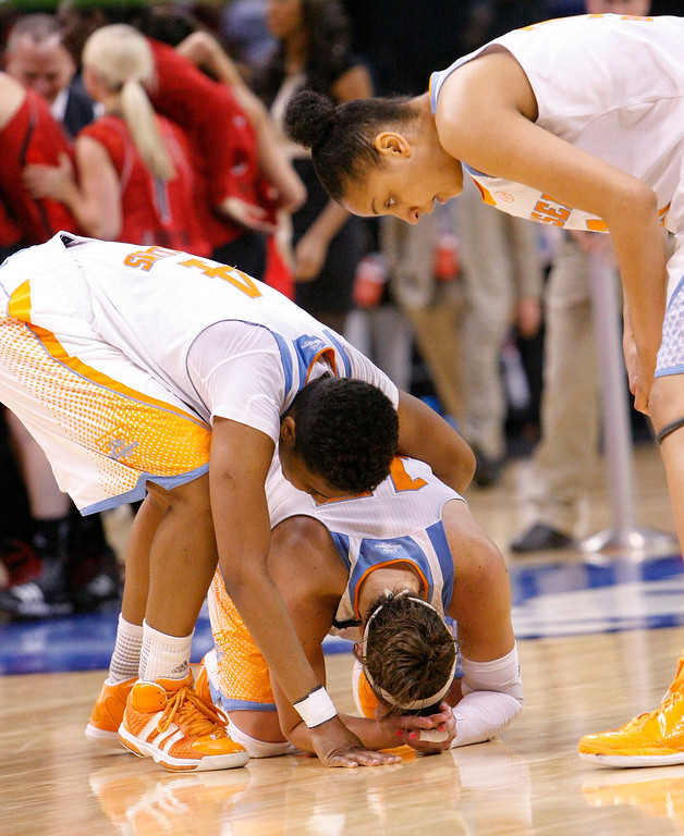 . Tennessee\'s Kamiko Williams, left, Taber Spani, center, and Cierra Burdick, right, react after Tennessee\'s 86-78 loss to Louisville in the regional final in the NCAA women\'s college basketball tournament in Oklahoma City, Tuesday, April 2, 2013. (AP Photo/Alonzo Adams)