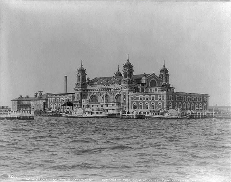 ". Ellis Island in 1905 On December 17, 1900, a magnificent new building opened on Ellis Island, to inspect and ""process\"" immigrants. Designed to handle approximately 500,000 people a year, it quickly proved to be inadequate for the numbers of of immigrants flooding into the United States from all parts of the world. (NPS Photo)"