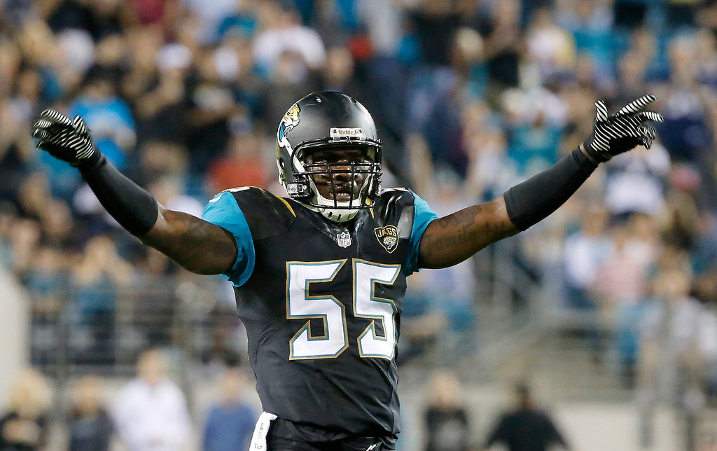 . Geno Hayes #55 of the Jacksonville Jaguars asks the crowd for noise during the game against the Houston Texans at EverBank Field on December 5, 2013 in Jacksonville, Florida.  (Photo by Sam Greenwood/Getty Images)