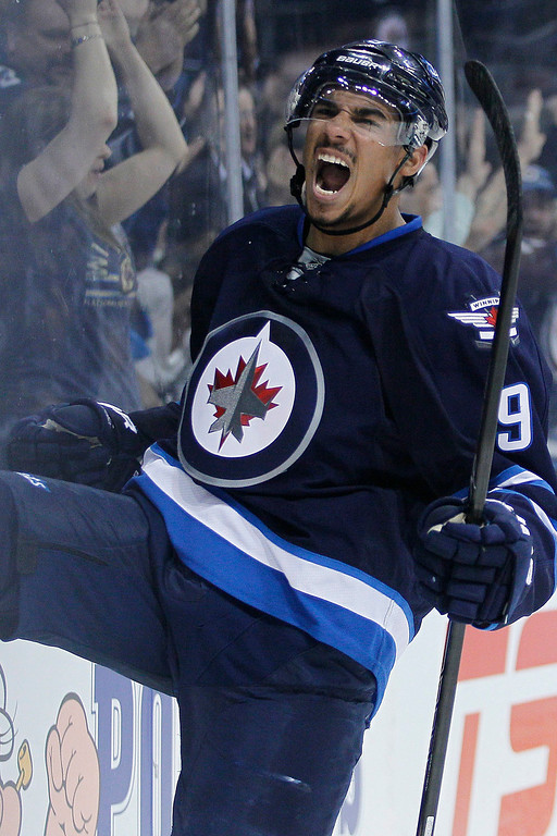 . Winnipeg Jets\' Evander Kane (9) celebrates his goal against the Colorado Avalanche during second period NHL action in Winnipeg on Wednesday, March 19, 2014. THE CANADIAN PRESS/John Woodsduring the second period of an NHL hockey game Wednesday, March 19, 2014, in Winnipeg, Manitoba. (AP Photo/The Canadian Press, John Woods)