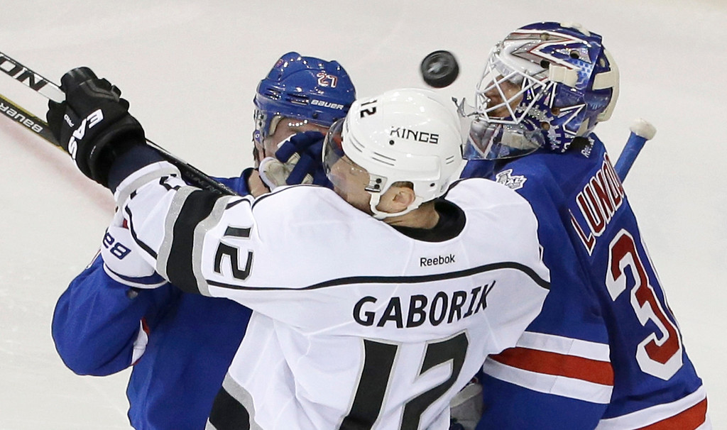 . New York Rangers defenseman Ryan McDonagh (27) and Rangers goalie Henrik Lundqvist (30) defend against Los Angeles Kings right wing Marian Gaborik (12) in the second period during Game 3 of the NHL hockey Stanley Cup Final, Monday, June 9, 2014, in New York. (AP Photo/Frank Franklin II)