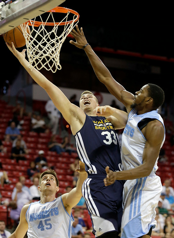 . Utah Jazz\'s Erik Murphy (33) shoots covered by Denver Nuggets\' Denzel Bowles (31) during the first half of an NBA summer league basketball game Tuesday, July 15, 2014, in Las Vegas. (AP Photo/Isaac Brekken)