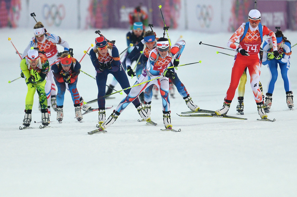 . Female athletes compete in the Biathlon mixed 2x6 km + 2x7,5 km Relay at the Laura Cross-Country Ski and Biathlon Center during the Sochi Winter Olympics on February 19, 2014 in Rosa Khutor near Sochi.    AFP PHOTO / ALBERTO PIZZOLI/AFP/Getty Images