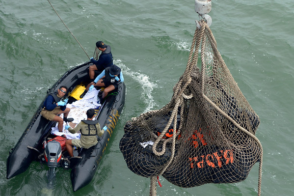 PHOTOS: Search continues for missing AirAsia Flight 8501 near Singapore