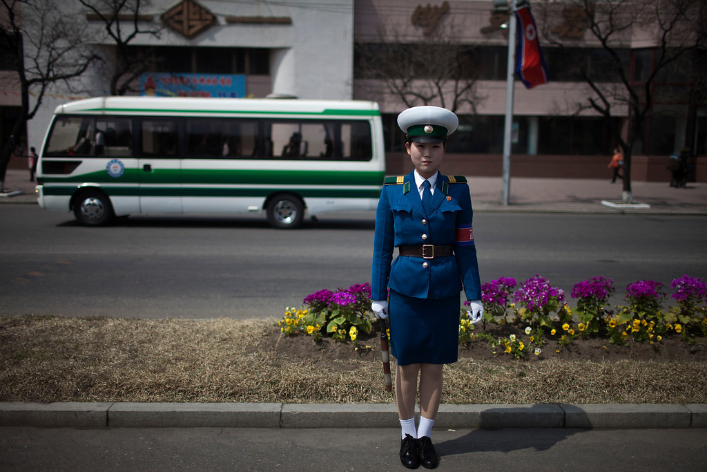 . A traffic policewoman stands on a street in Pyongyang, North Korea, Monday, April 15, 2013. (AP Photo/Alexander F. Yuan)