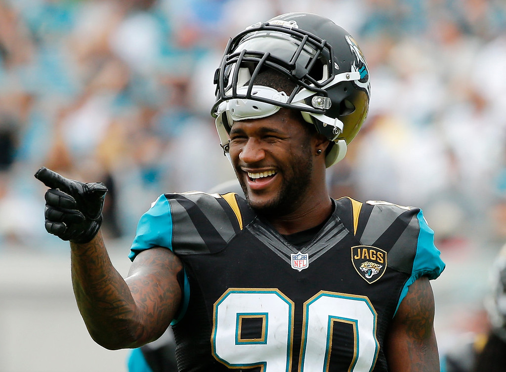 . Andre Branch #90 of the Jacksonville Jaguars points and smiles during the game against the Arizona Cardinals at EverBank Field on November 17, 2013 in Jacksonville, Florida.  (Photo by Sam Greenwood/Getty Images)