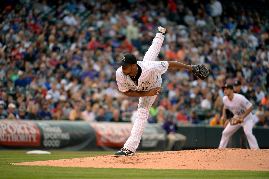 . DENVER, CO - MAY 06: Colorado Rockies starting pitcher Juan Nicasio (12) delivers a pitch in the second inning against the Texas Rangers May 6, 2014 at Coors Field. (Photo by John Leyba/The Denver Post)