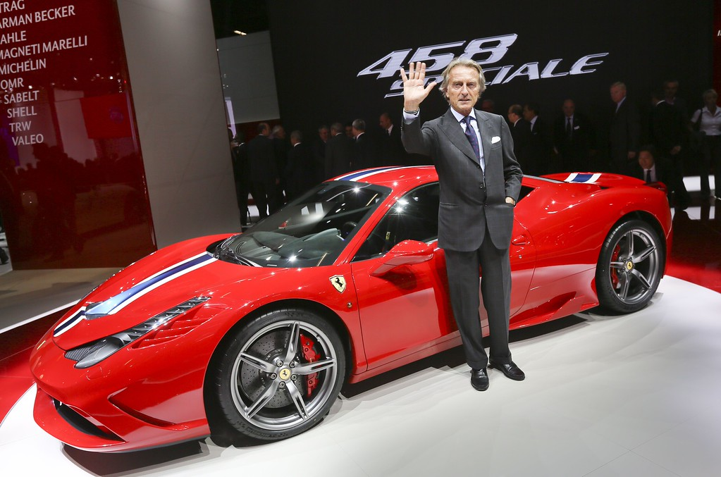 . Ferrari chairman Luca Cordero di Montezemolo poses next to a Ferrari 458 Speciale car during the media day of the IAA (Internationale Automobil Ausstellung) international motor show in Frankfurt am Main, western Germany, on September 10, 2013.   AFP PHOTO / DPA / FRANK RUMPENHORST /AFP/Getty Images