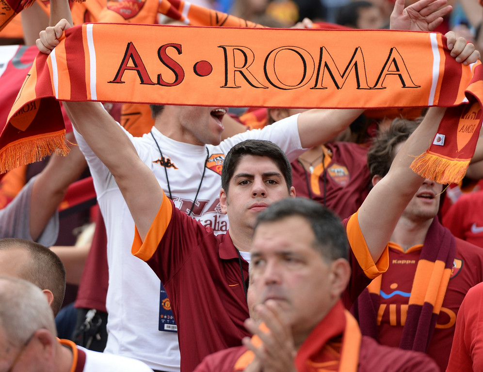. AS Roma supporters stood proud despite the loss. Manchester United defeated AS Roma 3-2 in an exhibition soccer game at Sports Authority Field in Denver Saturday afternoon, July 27, 2014. Photo by Karl Gehring/The Denver Post
