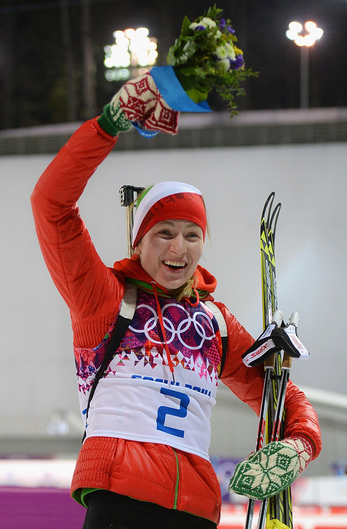. Gold medalist Darya Domracheva of Belarus celebrates during the flower ceremony for the Women\'s 12.5 km Mass Start during day ten of the Sochi 2014 Winter Olympics at Laura Cross-country Ski & Biathlon Center on February 17, 2014 in Sochi, Russia.  (Photo by Harry How/Getty Images)
