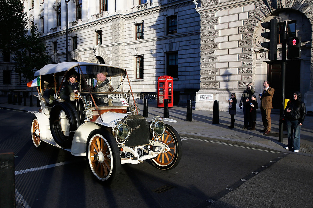 . A car drives through Parliament Square during the Royal Automobile Club\'s annual Veteran Car Run in Hyde Park on November 3, 2013 in London, England. Around 500 eligible pre-1905 cars take part in The Royal Automobile Club\'s annual 60-mile drive from Hyde Park in central London to the seafront on the Sussex resort of Brighton. It is the longest running motoring event in the world, and attracts entrants from across the globe.  (Photo by Matthew Lloyd/Getty Images)