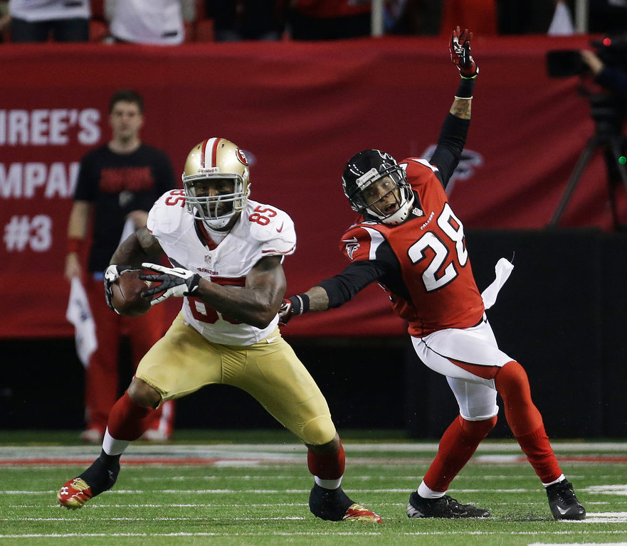 . San Francisco 49ers\' Vernon Davis catches a pass in front of Atlanta Falcons\' Thomas DeCoud during the first half of the NFL football NFC Championship game Sunday, Jan. 20, 2013, in Atlanta. (AP Photo/Dave Martin)