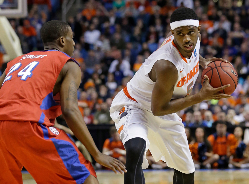 . Syracuse\'s C.J. Fair (5) protects the ball from Dayton\'s Jordan Sibert (24) during the first half of a third-round game in the NCAA men\'s college basketball tournament in Buffalo, N.Y., Saturday, March 22, 2014. (AP Photo/Frank Franklin II)