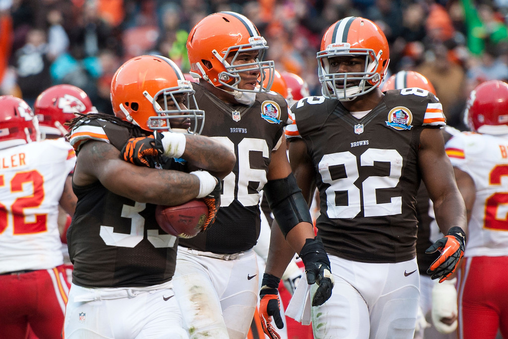 . CLEVELAND, OH - DECEMBER 09: Running back Trent Richardson #33, guard Shawn Lauvao #66 and tight end Benjamin Watson #82 of the Cleveland Browns celebrate after a touchdown during the second half against the Kansas City Chiefs at Cleveland Browns Stadium on December 9, 2012 in Cleveland, Ohio. The Browns defeated the Chiefs 30-7. (Photo by Jason Miller/Getty Images)