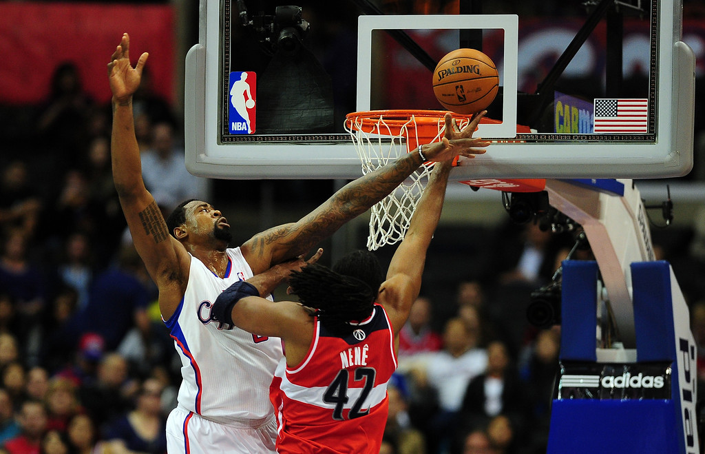 . Matt Barnes of the Los Angeles Clippers (L) tries to block Nene of the Washington Wizards (#42) from scoring during their NBA game in Los Angeles on January 19, 2013.  FREDERIC J. BROWN/AFP/Getty Images