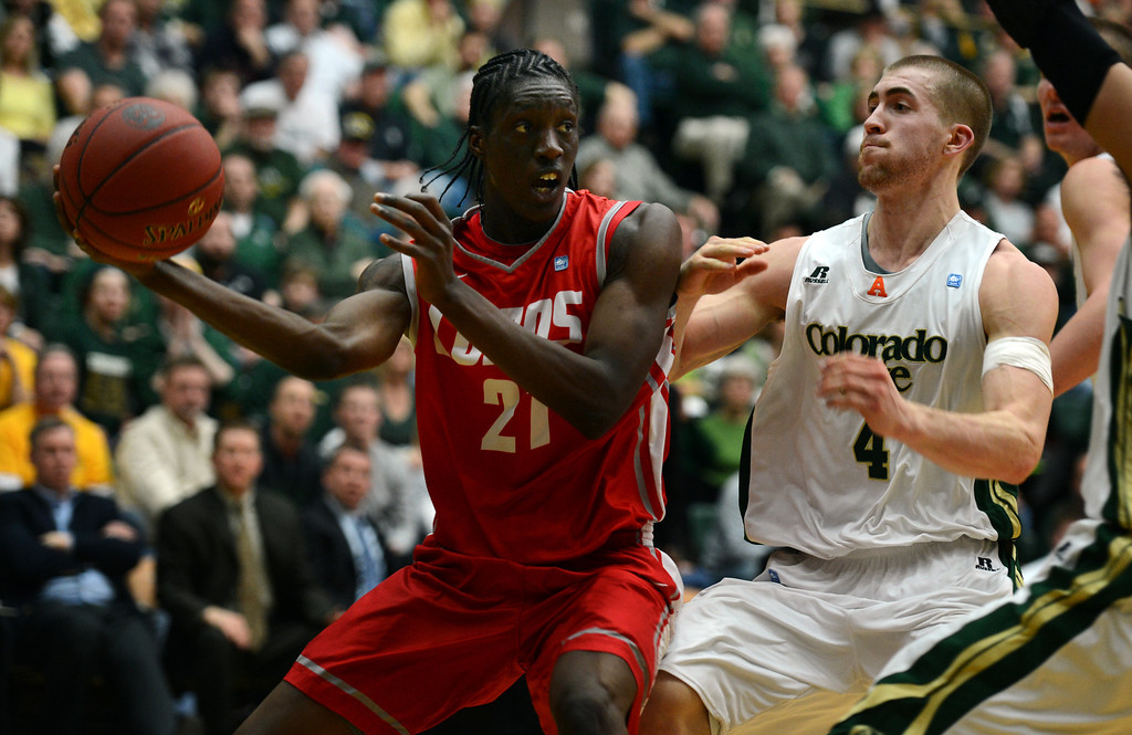 . Fort COLLINS, CO. - FEBRUARY 23: New Mexico Tony Snell keeps the ball from CSU Pierce Hornung during first half action at Moby Arena in Fort Collin, CO February  24, 2013. The Colorado State Rams lost to the New Mexico Lobos 91-82. (Photo By Craig F. Walker/The Denver Post)