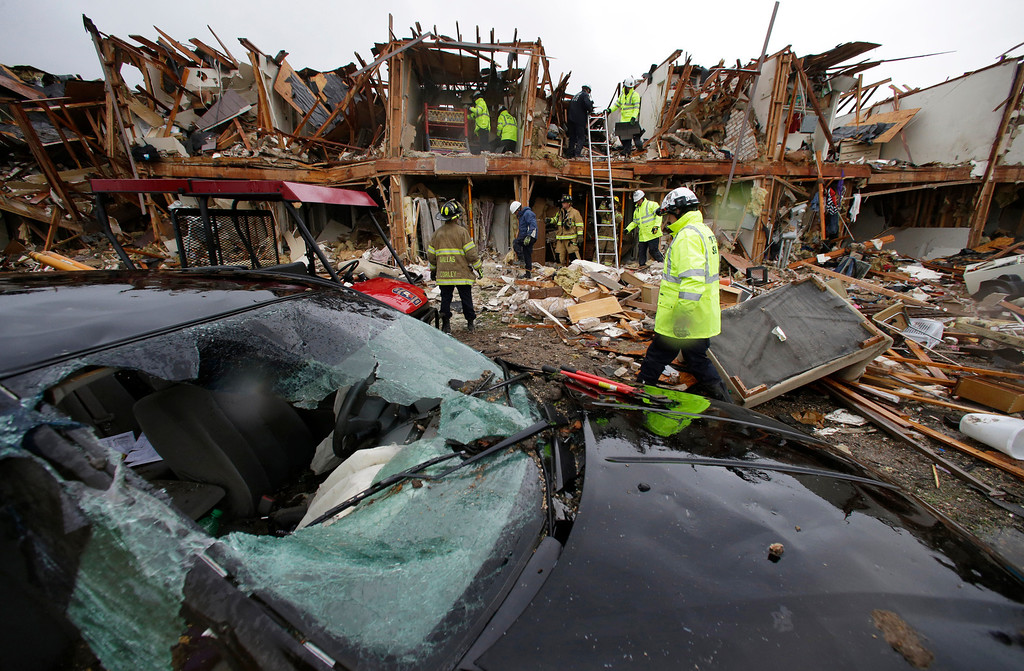 . A smashed car sits in front of an apartment complex destroyed by an explosion at a fertilizer plant in West, Texas, as firefighters conduct a search and rescue Thursday, April 18, 2013. A massive explosion occurred at the West Fertilizer Co. (AP Photo/LM Otero)