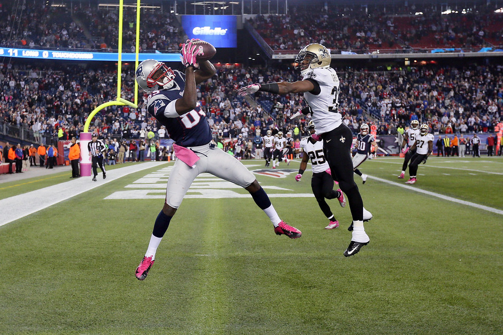 . Wide receiver Kenbrell Thompkins #85 of the New England Patriots catches the game winning touchdown in front of cornerback Jabari Greer #33 of the New Orleans Saints in the closing seconds of the Patriots 30-27 win at Gillette Stadium on October 13, 2013 in Foxboro, Massachusetts.  (Photo by Rob Carr/Getty Images)