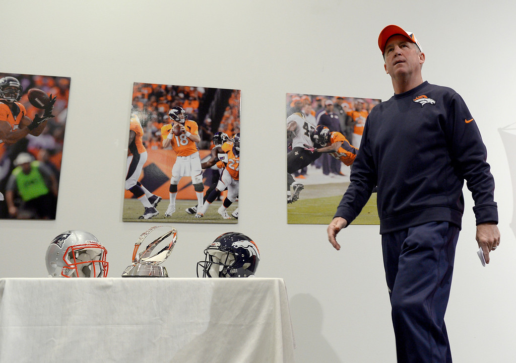 . Denver Broncos head coach John Fox walks off from the podium after his press conference The NFL provided the Lamar Hunt Trophy along with the New England Patriots helmet and Denver Broncos helmet during press conferences January 15, 2014 at Dove Valley. The Lamar Hunt Trophy goes to the winner of the AFC Championship game. (Photo by John Leyba/The Denver Post)