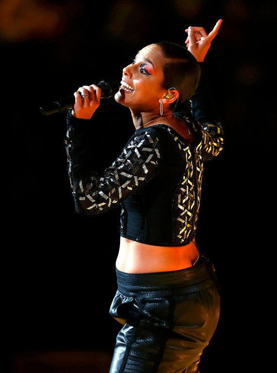 . Singer Alicia Keys performs at half time during the NBA All-Star basketball game in Houston, Texas, February 17, 2013.  REUTERS/Jeff Haynes (UNITED STATES  - Tags: SPORT BASKETBALL ENTERTAINMENT)
