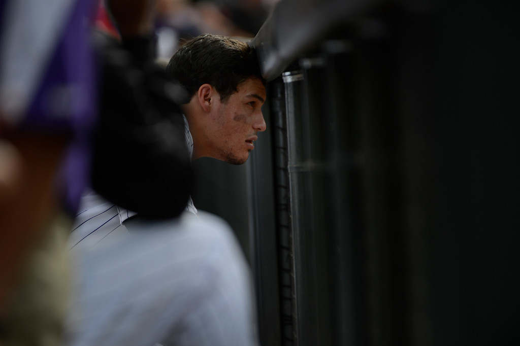 . DENVER, CO - JUNE 27: Colorado Rockies Nolan Arenado looks out onto the field from the dugout against the San Francisco Giants at Coors Field Saturday afternoon, June 29, 2013. Arenado hit a walk-off game winning single to defeat the Giants 2-1. (Photo By Andy Cross/The Denver Post)