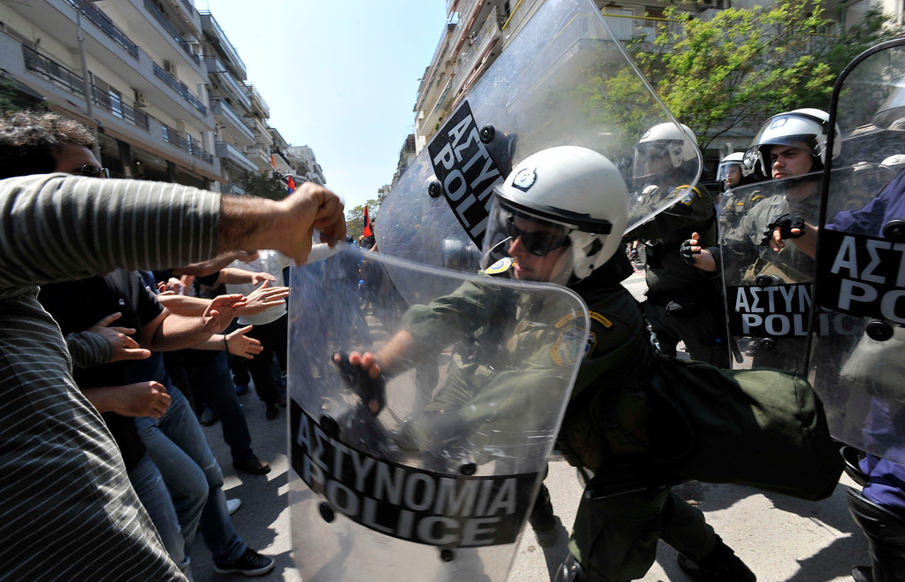 . Police clash with protesters at the annual rally to protest the mass killings of Armenians in Ottoman Turkey nearly a century ago in Thessaloniki, Greece on Wednesday April 24, 2013. About 250 protesters, mostly from Greek-Armenian groups, gathered outside the Turkish consulate. About 20 countries worldwide, including Greece, as well as the European parliament recognize the mass killings as an act of genocide, despite strong objections from Turkey. (AP Photo/Nikolas Giakoumidis)