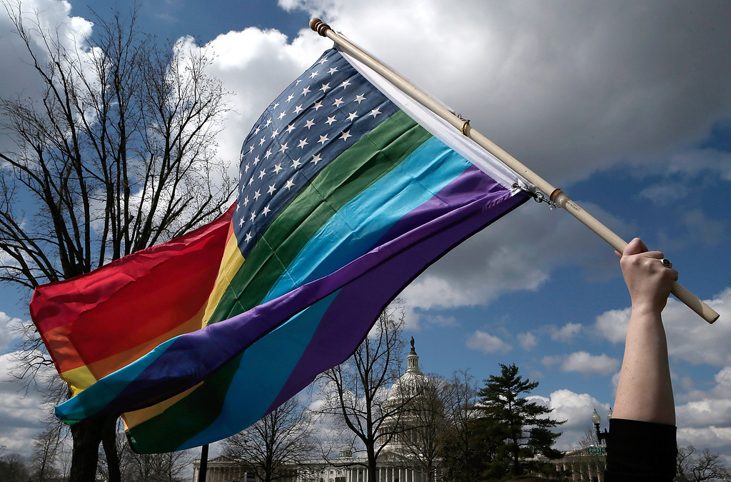 . An equal rights supporter waves a flag during demonstration in front of the U.S. Supreme Court March 26, 2013 in Washington, DC.   (Photo by Win McNamee/Getty Images)