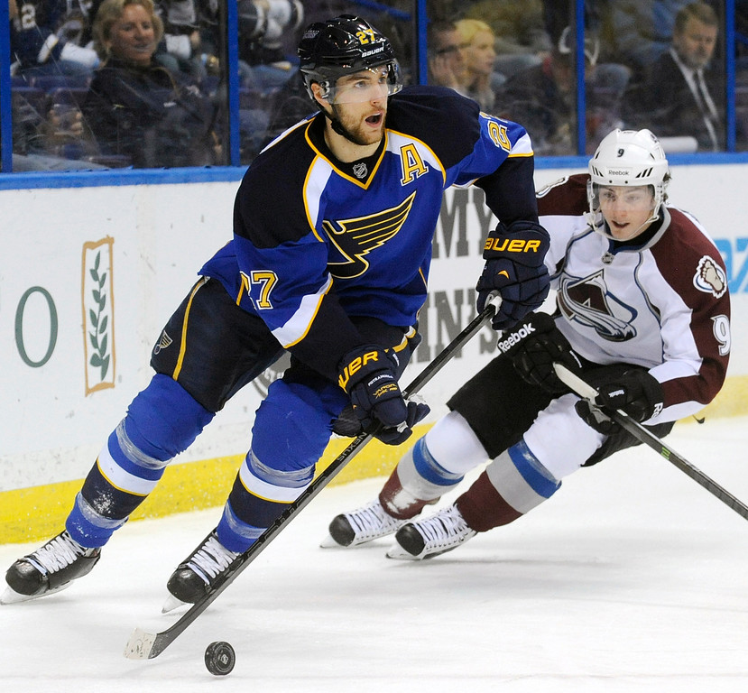 . St. Louis Blues\' Alex Pietrangelo (27) controls the puck around Colorado Avalanche\'s Matt Duchene (9) in the first period of an NHL hockey game Tuesday, April 23, 2013, in St. Louis. (AP Photo/Bill Boyce)