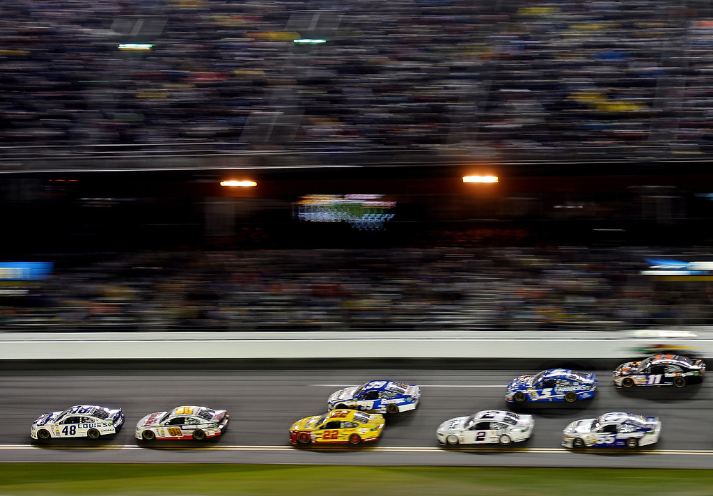 . Jimmie Johnson, driver of the #48 Lowe\'s Chevrolet, leads a pack of cars during the NASCAR Sprint Cup Series Daytona 500 at Daytona International Speedway on February 23, 2014 in Daytona Beach, Florida.  (Photo by Jared C. Tilton/Getty Images)