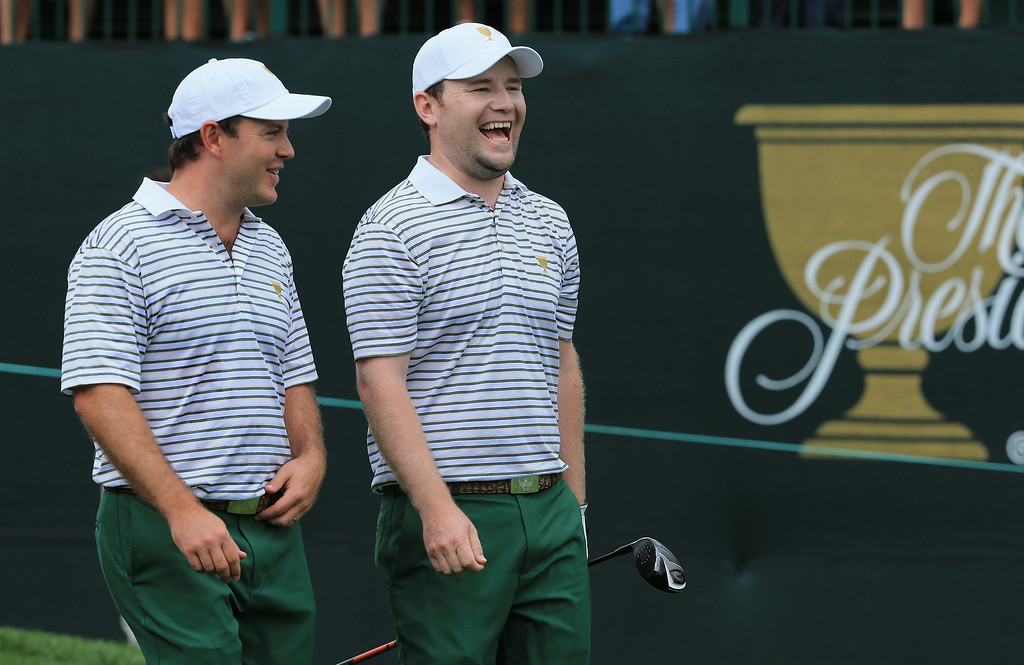 . DUBLIN, OH - OCTOBER 03:  Richard Sterne (L) and Branden Grace of South Africa and the International Team walk off the first tee during Day One Four-Ball Matches at the Muirfield Village Golf Club on October 3, 2013  in Dublin, Ohio.  (Photo by David Cannon/Getty Images)