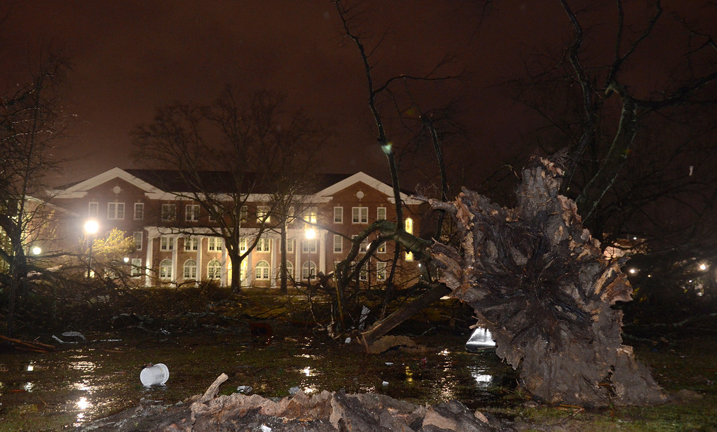 . Trees lie uprooted in front of the University of Southern Mississippi campus in Hattiesburg, Miss., after an apparent tornado Sunday, Feb. 10, 2013. (AP Photo/Chuck Cook)