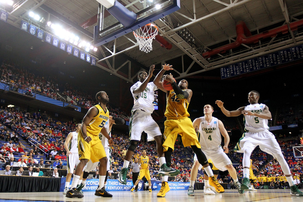 . LEXINGTON, KY - MARCH 21:  Alex Oriakhi #42 of the Missouri Tigers fights for the loose ball against Gerson Santo #15 of the Colorado State Rams during the second round of the 2013 NCAA Men\'s Basketball Tournament at the Rupp Arena on March 21, 2013 in Lexington, Kentucky.  (Photo by Andy Lyons/Getty Images)
