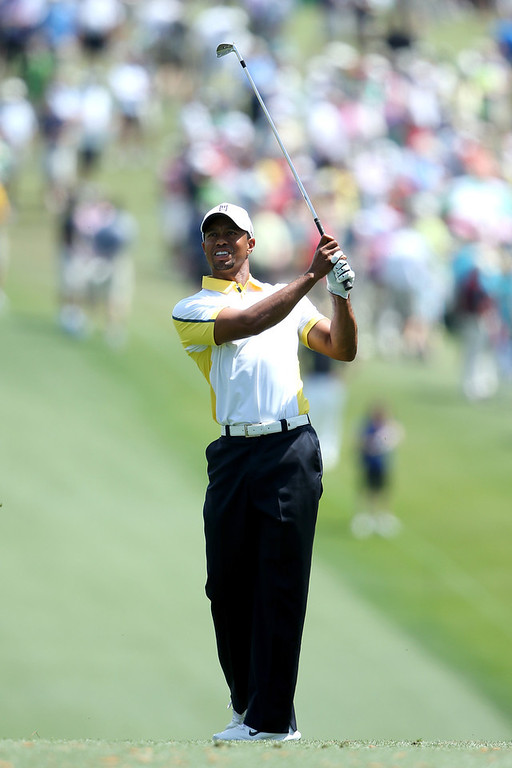 . Tiger Woods of the United States hits a shot on the first fairway during the second round of the 2013 Masters Tournament at Augusta National Golf Club on April 12, 2013 in Augusta, Georgia.  (Photo by Andrew Redington/Getty Images)