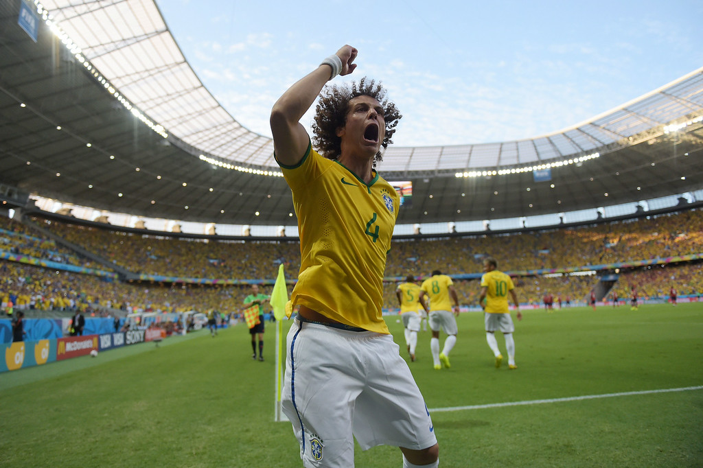 . Brazil\'s defender David Luiz celebrates after Brazil scored during the quarter-final football match between Brazil and Colombia at the Castelao Stadium in Fortaleza during the 2014 FIFA World Cup on July 4, 2014. EITAN ABRAMOVICH/AFP/Getty Images