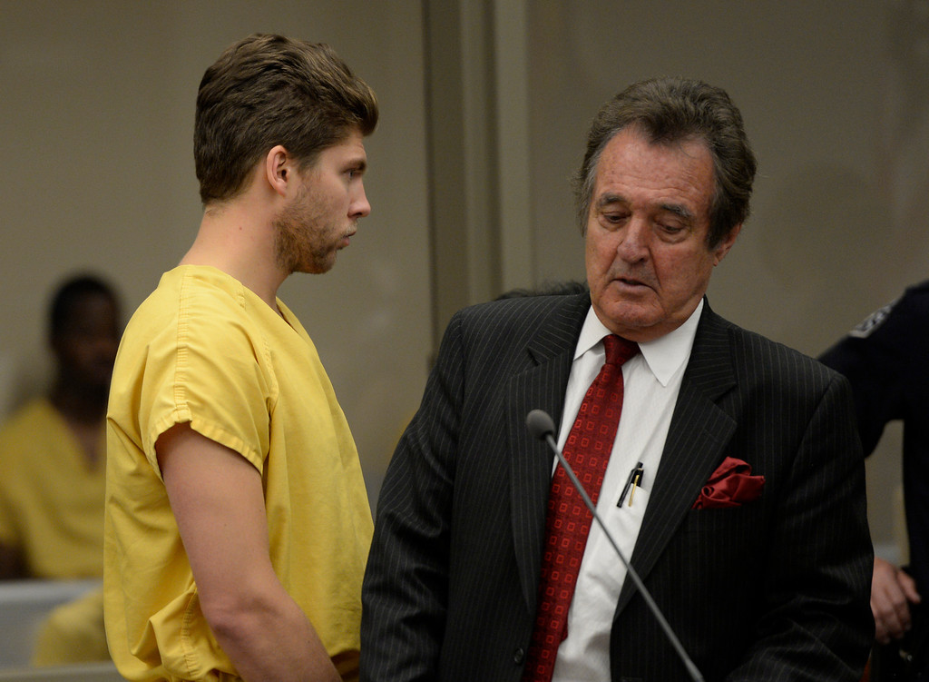 . Semyon Varlamov, starting goaltender for the Colorado Avalanche, with his attorney Jack Rotole, appears in court in Denver on kidnapping and assault charges related to the case, which the woman said happened Monday at their apartment, October 31, 2013. The judge set his bond at $5,000. (Photo By RJ Sangosti/The Denver Post)