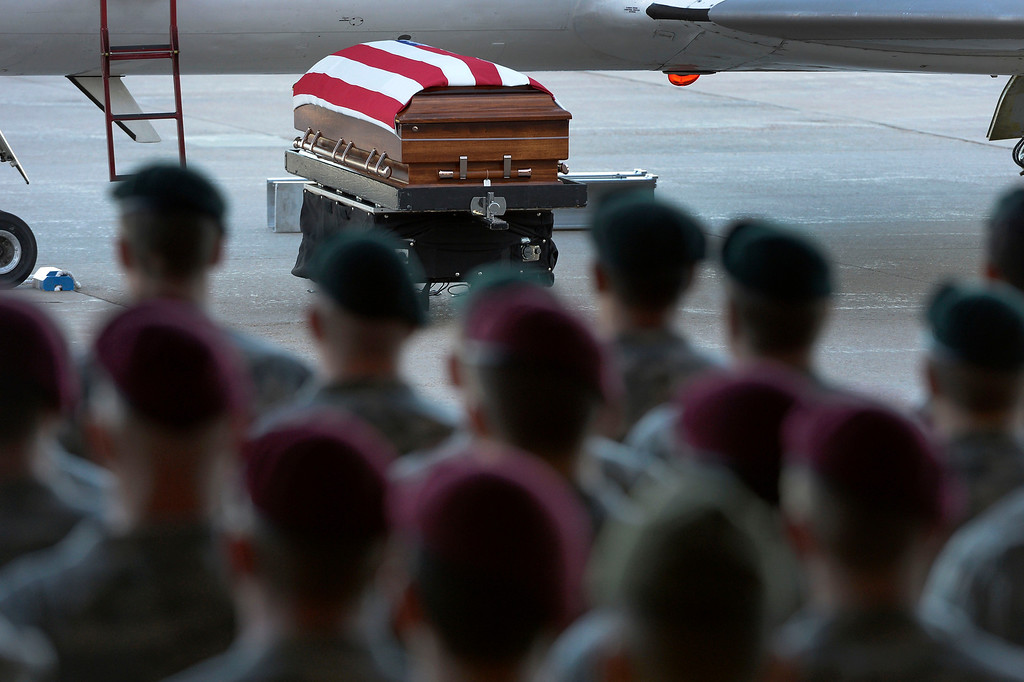 . Green Beret and Airborne stand at attention as military officials brought the body of special forces staff sergeant Liam Nevins, 32, home from Dover AFB September 30, 2013 at Buckley AFB. Nevins, of Denver, was killed two weekends ago in Afghanistan. (Photo by John Leyba/The Denver Post)