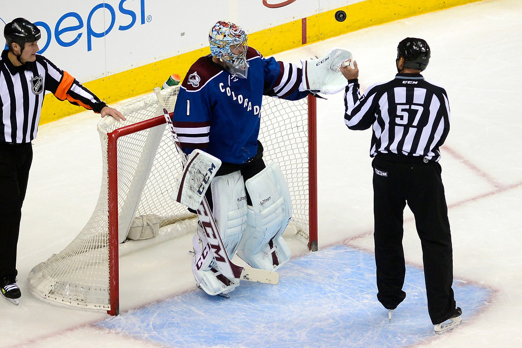 . Semyon Varlamov (1) of the Colorado Avalanche flips the puck to a referee after stopping a shot on goal by Evander Kane (9) of the Winnipeg Jets during the second period of action.  (Photo by AAron Ontiveroz/The Denver Post)